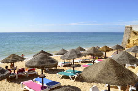 Tourists enjoying sunny weather on Armacao De Pera Beach on the Algarve coast Stock Photo