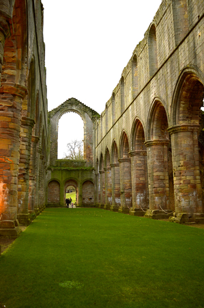 The historical 13th century Fountains Abby Interior of the abbey church looking down the nave Stock Photo