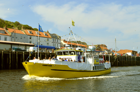 Summer Queen tourist cruise ship returning to Whitby harbour