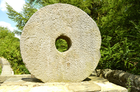 Millstones or mill stones are used for grinding Stock Photo