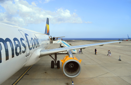 Passengers disembarking form a Thomas Cook Airbus A320 aircraft in Fuerteventura airport
