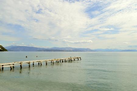 Ipsos Beach pier in Corfu a Greek island in the Ionian sea