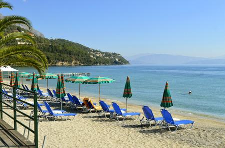 Sun loungers on Ipsos Beach in Corfu a Greek island in the Ionian sea