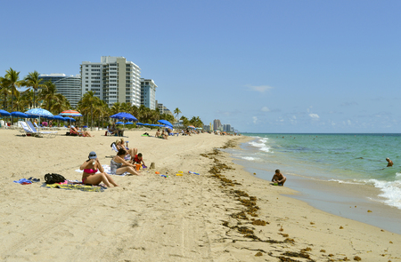 Tourists on Fort Lauderdale beach enjoying the sun