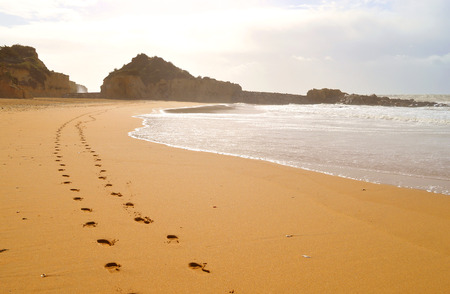 Footprints in the sand on Albufeira beach on the Algarve coast of Portugal Stock fotó