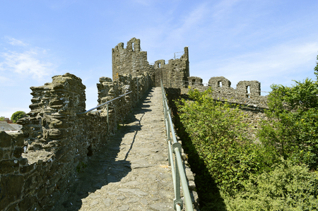 The historical medieval town wall surrounding Conwy town Stock Photo