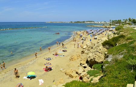 Tourists on Paphos beach a tourist resort in Cyprus