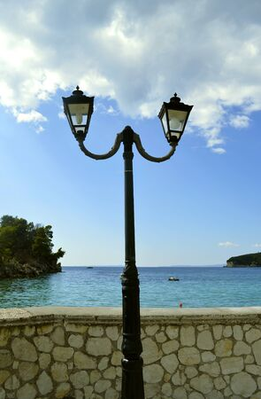 Paxos harbour street lamp a small Greek island south of Corfu in the Ionian sea Banque d'images - 140990763