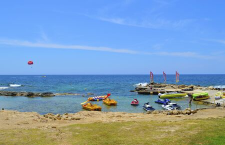 Paphos, Cyprus, Greece - June 5, 2018 : Boats for hire on Paphos Beach a popular tourist resort in Cyprus