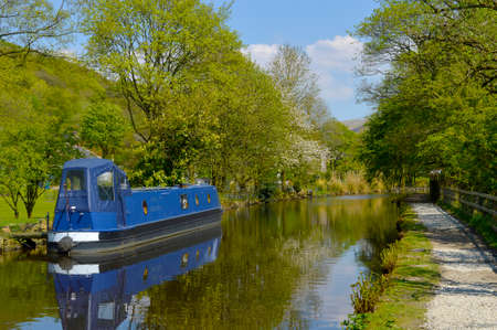 Canal barge on the Huddersfield Narrow Canal in Friezland Saddleworth Moor, Oldham