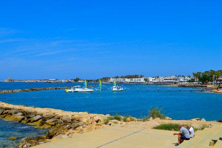 Paphos, Cyprus, Greece - June 5, 2018 : Tourists resting in Paphos harbour a popular tourist resort in Cyprus Sajtókép