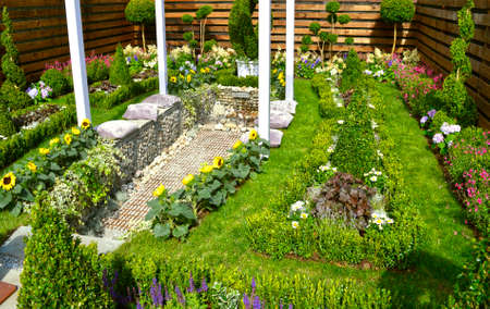 Cottage garden with a water feature and flowerbeds