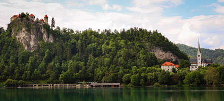 View of the Bled castle and church from a boat on the lake