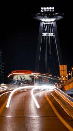 Public transportation bus during night with SNP bridge in the background Standard-Bild - 157155493