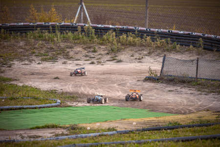 3 RC buggies racing on an outdoor track