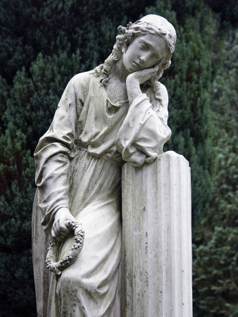 grieving: Stone statue of a grieving young woman  Stock Photo