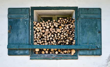 brushwood: Window With Firewood - Weathered old window of an hermitage with firewood for the cold winter