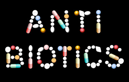 The word ANTIBIOTICS composed with different pills and capsules. Isolated vector illustration on black background.