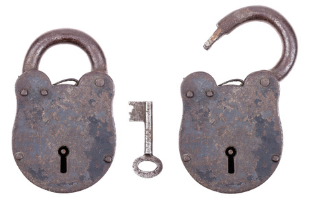 Locked and unlocked medieval padlock with key, made of iron and slightly rusty. Portable lock with a shackle that may be passed through an opening to protect against unauthorized use, theft, vandalism or harm.