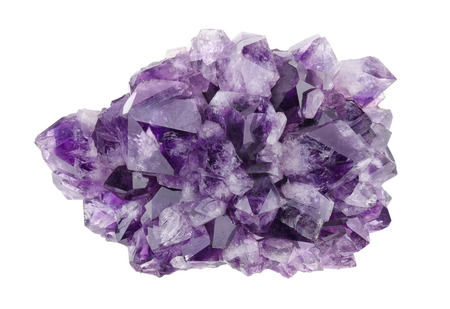 Amethyst directly above over white background, a violet variety of quartz, often used in jewelry. Silica, silicon dioxide, SiO2.