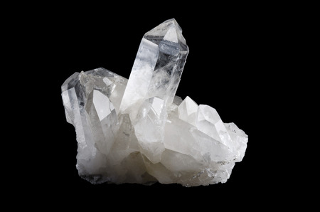 silica: Quartz crystal cluster horizontal on black background, mineral also used as semi-precious gemstones. Silica, silicon dioxide, SiO2.