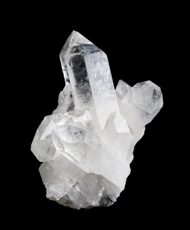 high size: Quartz crystal cluster high size on black background, mineral also used as semi-precious gemstones. Silica, silicon dioxide, SiO2. Stock Photo