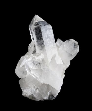 silica: Quartz crystal cluster high size on black background, mineral also used as semi-precious gemstones. Silica, silicon dioxide, SiO2. Stock Photo