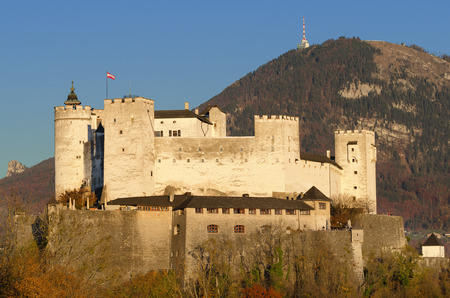 crenelation: Salzburg fortress Hohensalzburg in Austria. Castle in front of Gaisberg mountain on the right and the Nockstein on the left. International festival city for classical music and birthplace of Mozart. Editorial