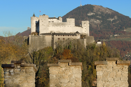 castle wall: Salzburg fortress Hohensalzburg in Austria and castle wall. Castle in front of Gaisberg mountain on the right and the Nockstein on the left. Festival city for classical music,  birthplace of Mozart.
