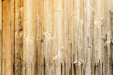 wood panelling: Old planked wood used as background. Wood panelling. Single planks are nailed to one surface. Photo.