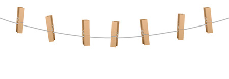 clothes pins: Clothes pins on a clothes line rope holding nothing.