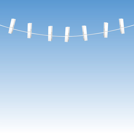 Clothes line rope with seven white clothes pins - blue sky background.