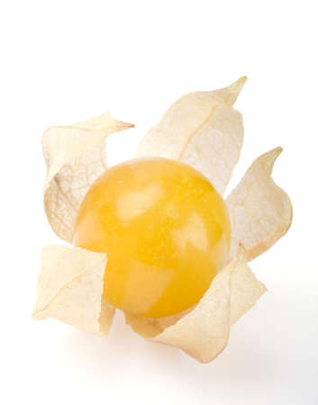 edible plant: Physalis single berry on white background. Edible ripe fruit of Physalis peruviana, a plant in the nightshade family. Light brown papery husk encloses the orange fruit. Macro photo close up from above Stock Photo