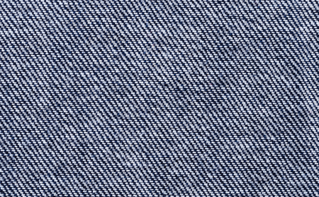 weft: Blue denim textile macro photo. Surface of sturdy cotton warp-faced fabric. Twill, type of textile weave with pattern of diagonal parallel ribs. Warp thread is dyed indigo, weft thread is left white.