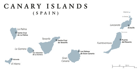 Canary Islands political map with capitals Las Palmas and Santa Cruz. The Canaries are an archipelago and autonomous community of Spain in Atlantic Ocean. Gray illustration, English labeling. Vector.