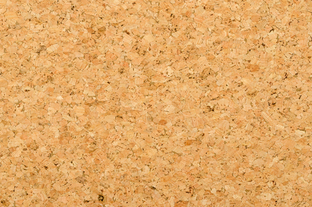 Cork sheet surface with coarse texture, comprised of rough grained cork oak, Quercus suber. Decorative panels and veneers, used as bulletin boards, floor and wall tiles. Top view. Photo. Stock Photo