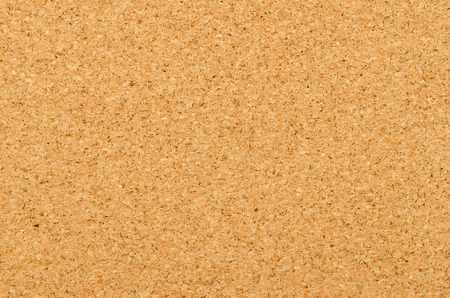 Cork sheet surface with fine texture, comprised of small grained cork oak, Quercus suber. Decorative panels and veneers, used as bulletin boards, floor and wall tiles. Top view. Photo. Stock Photo