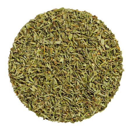 Dried savory. Herb circle from above isolated over white. Disc made of chopped summer savory, Satureja hortensis, a green herb and seasoning for barbecues, stews and sauces. Closeup. Macro food photo.