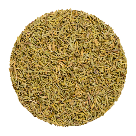 Dried thyme. Herb circle from above, isolated, over white. Disc made of minced stems. Green herb, Thymus vulgaris, a relative of oregano. Culinary spice and vegetable. Closeup. Macro food photo.