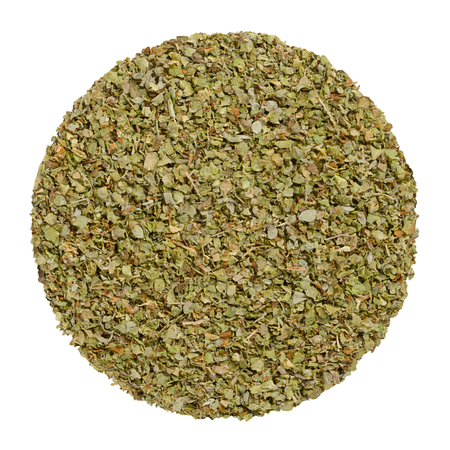 Dried marjoram, herb circle from above, isolated, over white. Disc made of Origanum majorana, also sweet, knotted or pot marjoram. Green herb and spice. Closeup. Macro food photo.