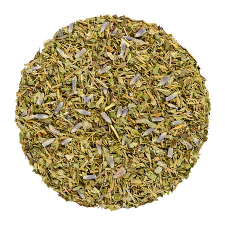 Dried Herbes de Provence, herb circle from above, isolated, over white. Disc, made of herbs of the Provence, France. Savory, rosemary, thyme, lavender, oregano and marjoram. Closeup. Macro food photo.