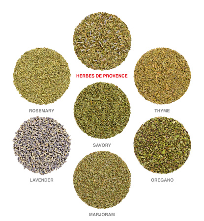 Herbes de Provence with single ingredients. Dried rosemary, savory and thyme are always used, lavender, marjoram and oregano is often added. Culinary herbs. Herbal circles. Food photo over white.