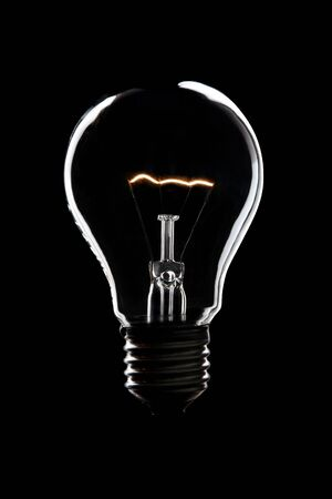 light bulb burning in the night with back background and copy space