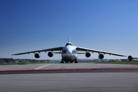 Antonow An 124 landing and off loading and taking off in Switzerland, with blue sky