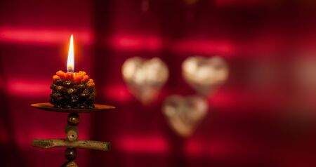 Christmas concept with red background and candles with copy space