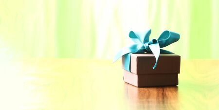 brown christmas present with ribbon with copy space