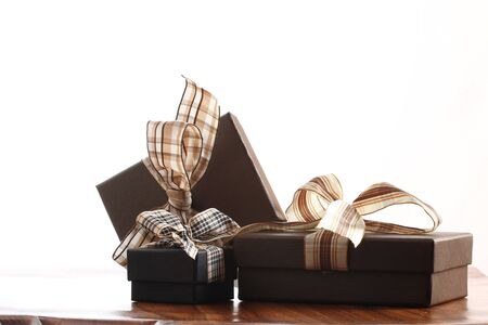 Presents on a table with a bow. Background space for copy. For Christmas, birthday or other holiday cards Stock Photo