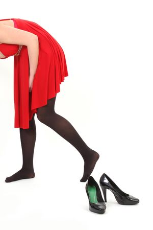 woman with red dress and back shoes on white background