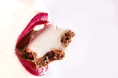 woman red lips eating tasty food with star cookie