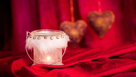 Red Christmas background with candle Stock Photo